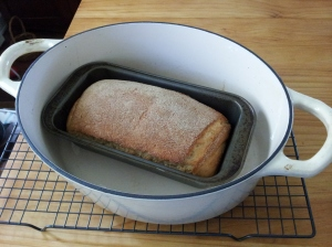 The loaf pan in the large casserole pot